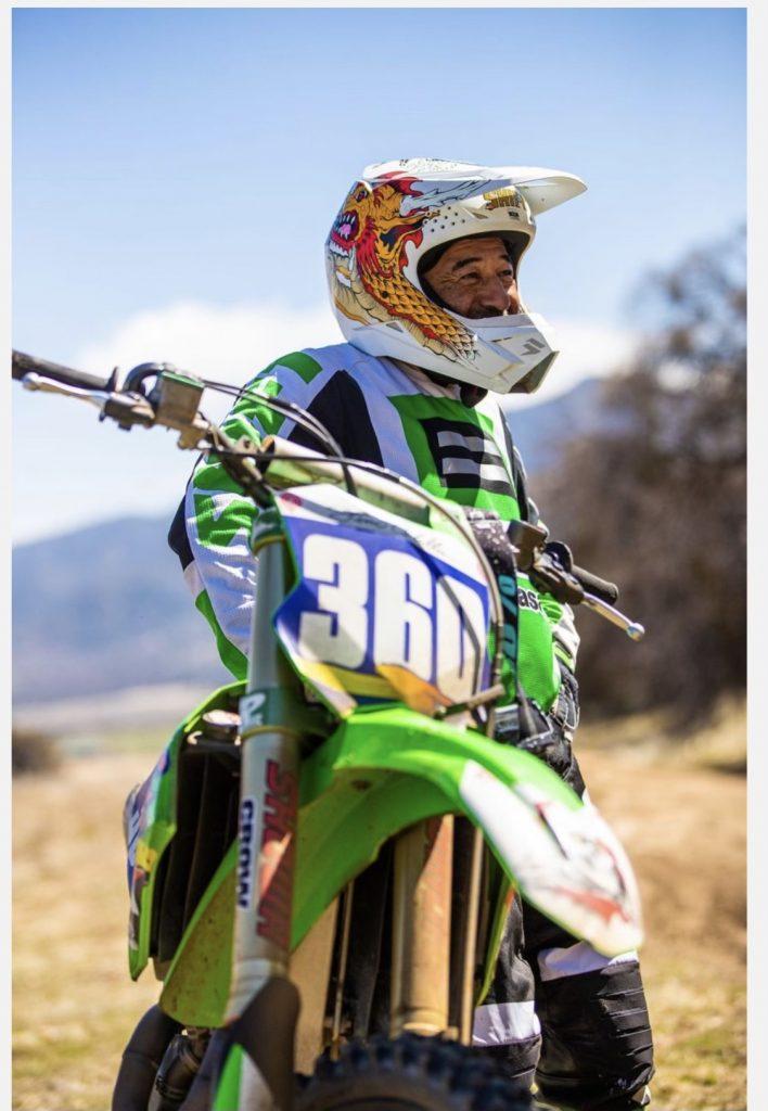 Steve Caballero sitting on his dirt bike